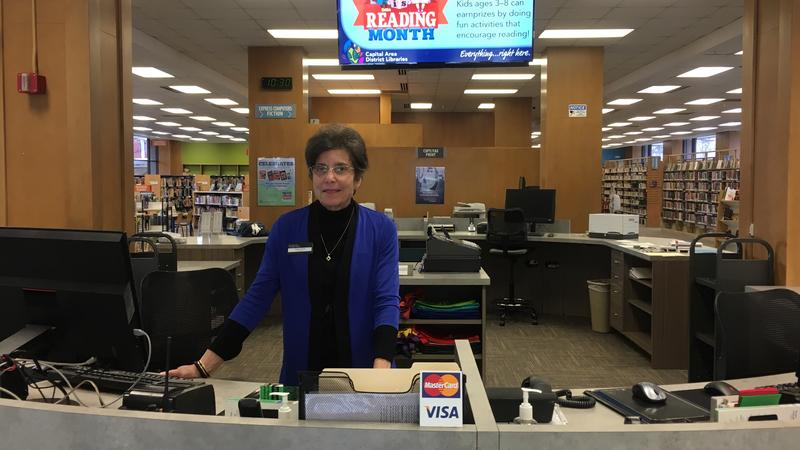 Head librarian Kathy Johnson at the downtown Lansing library service desk
