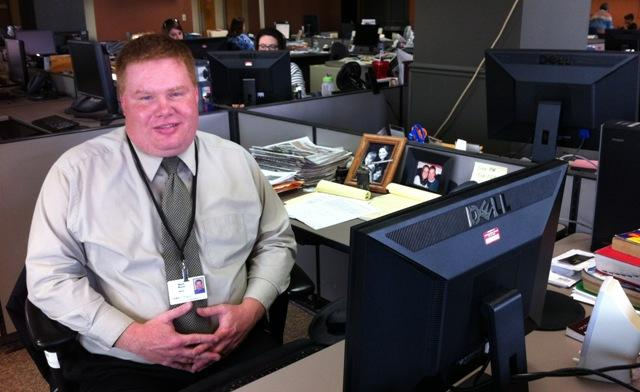 Lansing State Journal columnist Mark Mayes now occupies the desk used by his predecessor, John Schneider.