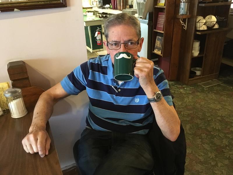 Mike Chappell with handlebar coffee mug photo
