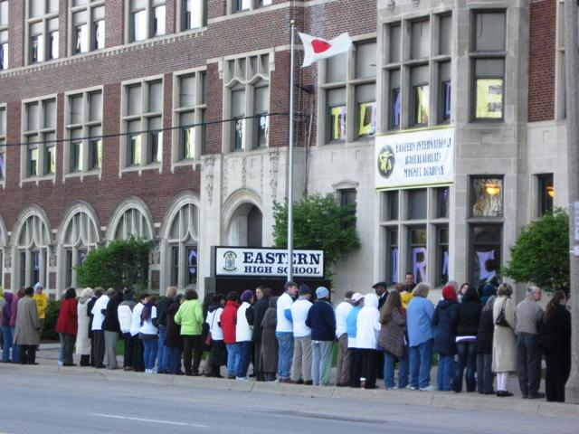 Hundreds of people turned their backs on the WBC demonstrators in a counter protest outside Lansing Eastern High School.
