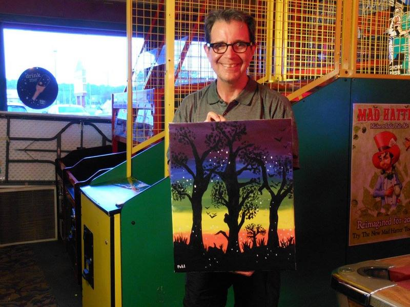 Scott Pohl with painting
