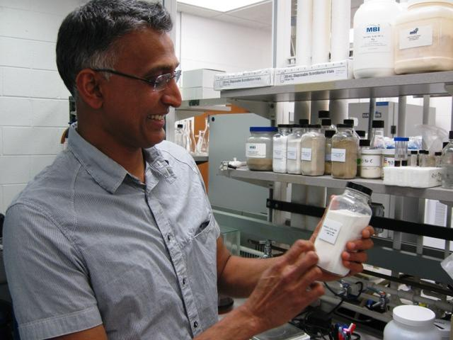 MBI CEO Bobby Bringi studies a container of fumaric acid.