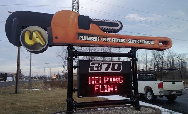 Plumber's union sign