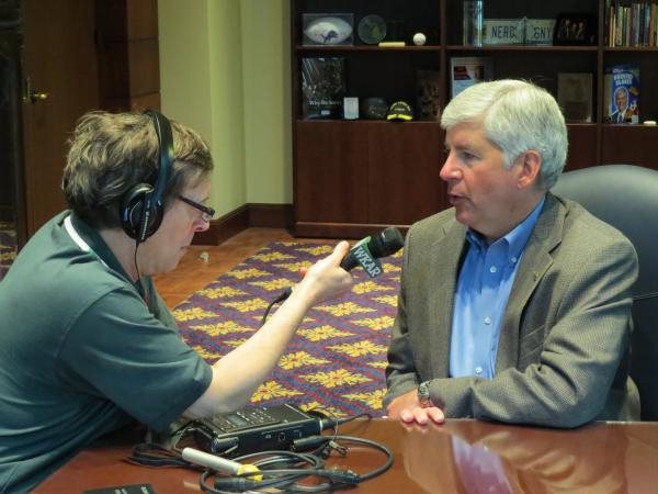 Governor Rick Snyder (right) speaks with host Mark Bashore at the Romney Building in Lansing.
