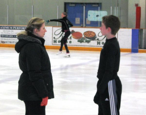 Oksana Yekusheva (left) coaches her son, Ivan Mohkov, in preparation for his performance at the U.S. National Figure Skating Championships in Omaha.