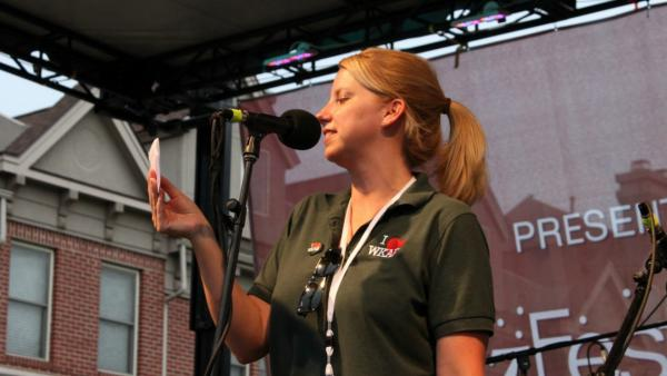 Susi Elkins introduces acts at the Old Town Blues Fest