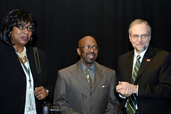 Earle Robinson (center) flanked by his wife Yvette and WKAR general manager Gary Reid.