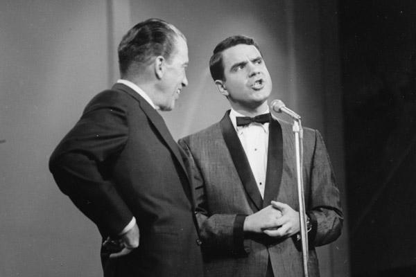 Ed Sullivan with Rich Little at microphone
