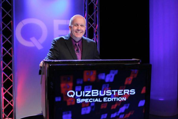 Matt Ottinger at QuizBusters podium