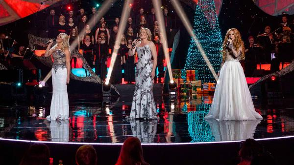 Three women performing on stage