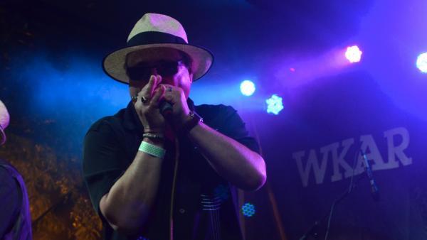 Sugar Ray playing harmonica on stage