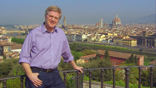 RIck Steves with city behind him