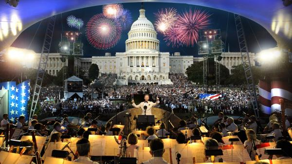 View over orchestra to the Capitol wth fireworks