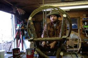 Justin Roberts works on a willow chair