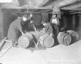 Prohibition agents destroying barrels of alcohol, 1921