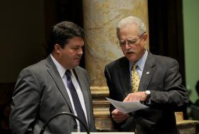 Sen. Ernie Harris (right), discusses a bill with Sen. Stan Humphries upon adjournment of the day's legislative session in the Kentucky Senate.