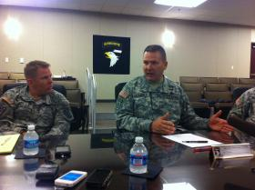 Brigadier General Mark Stammer, senior commander of Fort Campbell's 101st Airborne Division, (right) speaks on the military installation's programs and policies addressing sexual harassment and assault within its ranks.