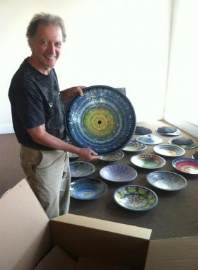 Craig Rhodes with artwork