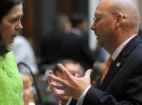 FRANKFORT— Rep. Kevin Sinnette, D-Ashland (right), discusses legislation with Rep. Tanya Pullin, D-South Shore, on the floor of the Kentucky House of Representatives.