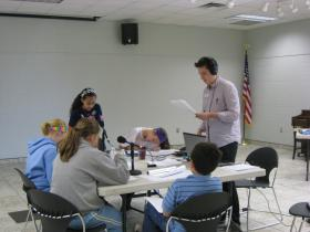 Matt records an original radio play with middle-school kids at the library during Fall Break.