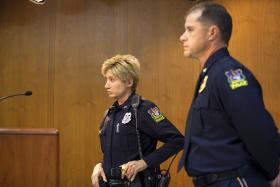 Officer Gretchen Morgan, left, and Chief Brandon Barnhill discuss the Anti-Bullying program at Tuesday's City Commission Meeting.