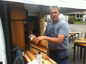Daniel Dimartile Louisville-based artist of innovative wood work, at the 2013 Paducah LowerTown Arts and Music Festival
