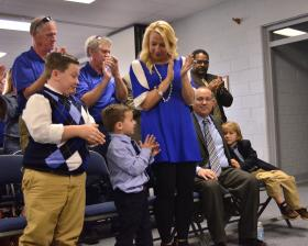 Donald Shively's Family applauding the news of his confirmation as Paducah Public Schools' Superintendent
