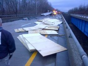 Lumber litters the bridge following the crash.
