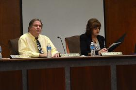 Paducah City Manager Jeff Pederson (left) and Paducah Mayor Gayle Kaler sit in council.