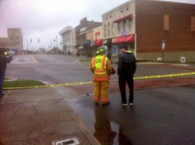 Officials block off the area around the building with the partial roof collapse.