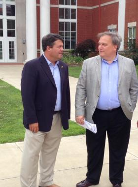 Stivers (right) chats with state Sen. Stan Humphries on MSU's campus.