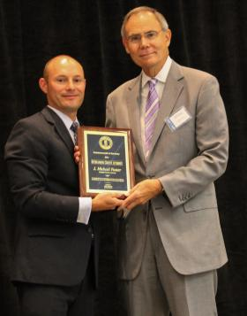 Christian County Attorney Mike Foster receiving his award for 2014 Outstanding County Attorney