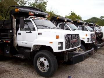auction-ready dump trucks