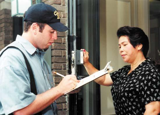 Census takers go door to door in their neighborhoods.