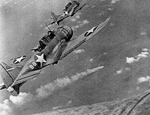US dive bombers approaching a Japanese heavy cruiser