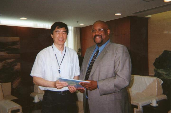 Presenting a copy of my Mother's children's story book as a gift to the president of China's Peoples Education Press in Beijing!!!!!Our guides in Tianamen Square.