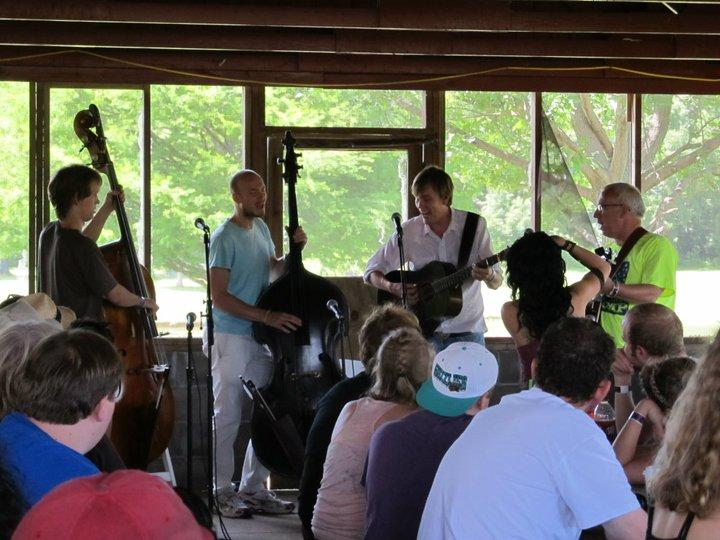Left to right: Paul Kowert, T Martin Stam, Chris Shouse, and John Laswell picking during a ROMP 2011 bass workshop.