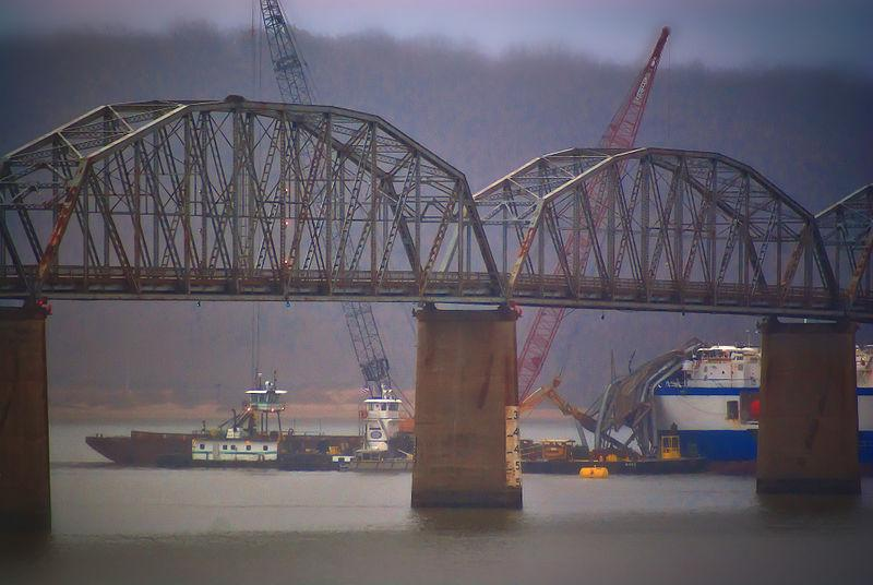 Cranes work on a damaged Eggners Ferry Bridge earlier this year.