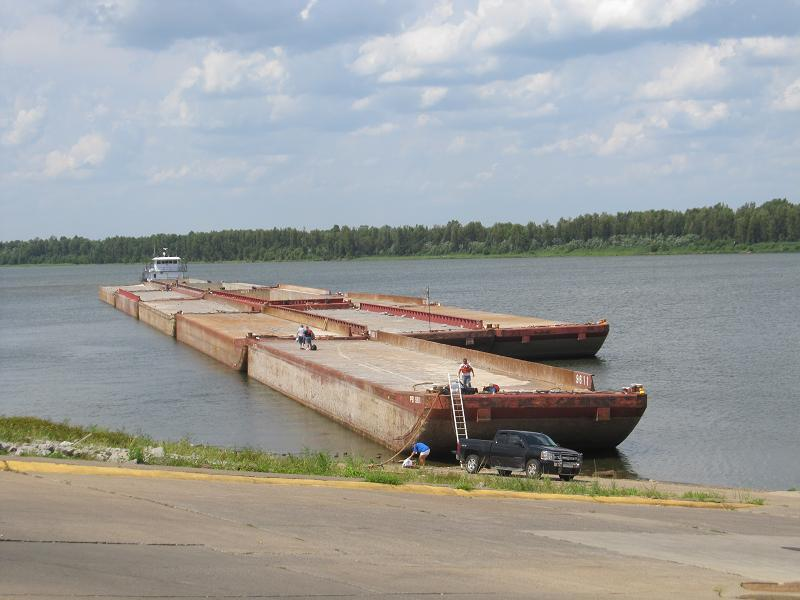 Captain Ehlman's ship docks at Paducah's riverfront to change crews.