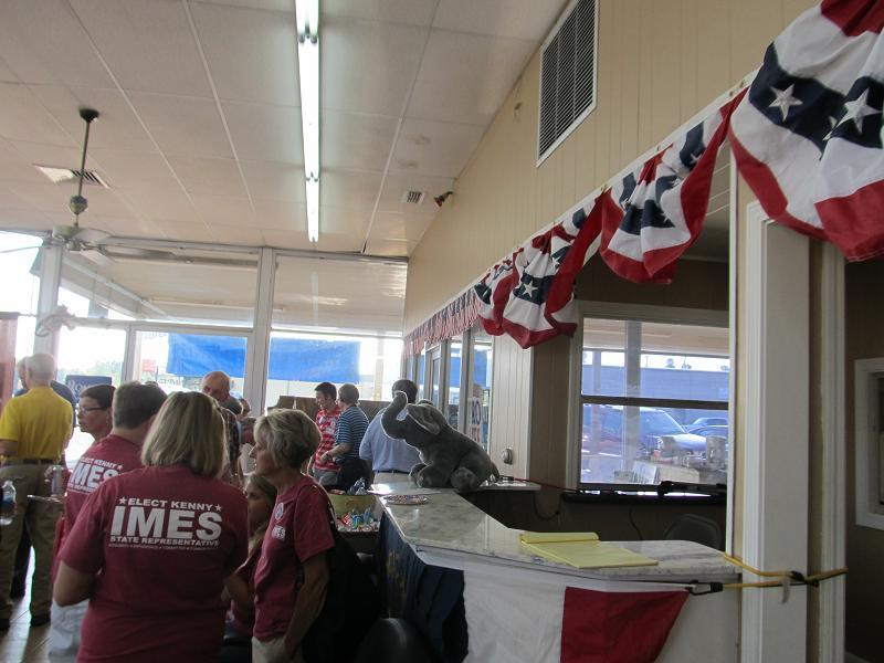 Imes (yellow) greets supporters during the opening of Calloway County Republican Party's headquarters in Murray.