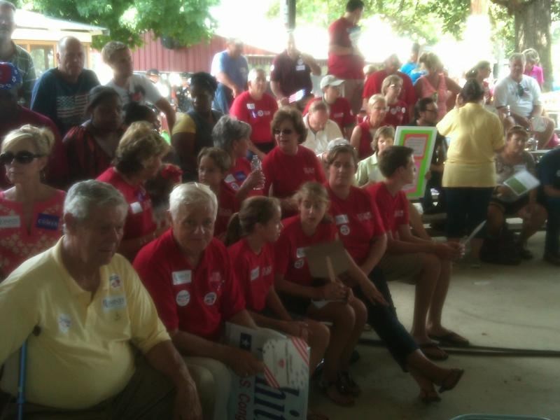 Stan Humphries supporters (in red T-shirts) cluster together for the political stumping.