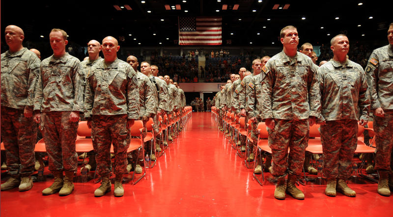 Soldiers of the 2/138th stand at attention during the