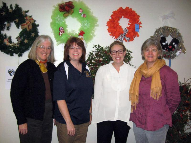 WKMS Station Manager Kate Lochte with judges Laura Dziekonski, Sara Falder, and Debi Danielson.