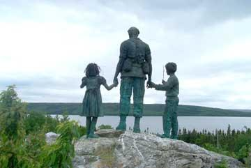 The Silent Witness Memorial overlooking Gander Lake.  The memorial was sculpted by the late Stephen Shields of Hopkinsville.  The empty area in between the sculpture and the lake was created by the crash of Arrow Air Flight 1285.