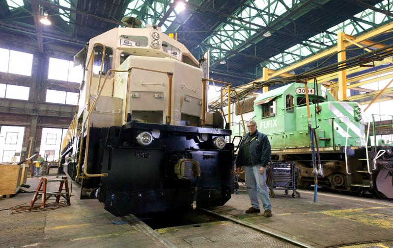Bob Pedersen stands next to one of VMV's unifinished locomotives.