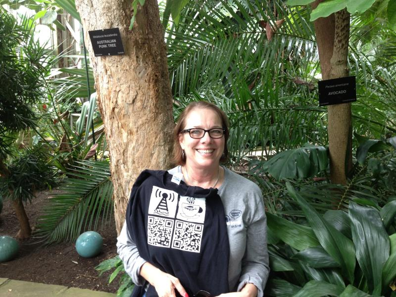 Robin Oakley of Cadiz wears WKMS proudly between two intersting trees at Anna Scripps Whitcomb Conservatory in Belle Isle in Detroit!