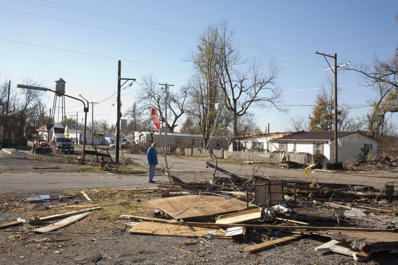 A Brookport resident inspects damage to the town on Monday.