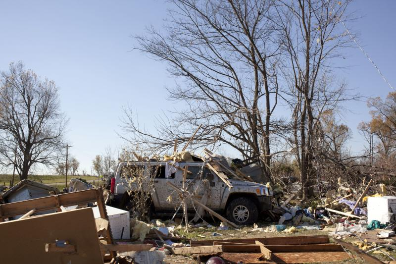 Debris piled upon an automobile in west Brookport.