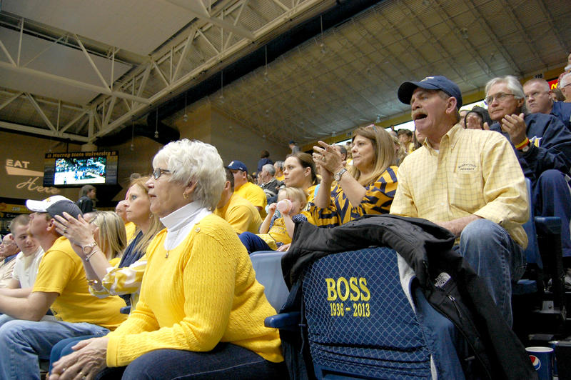 Gearl Suiter's family including his wife Jeannette and son Larry sit around his empty chair at the Racers' last home game.