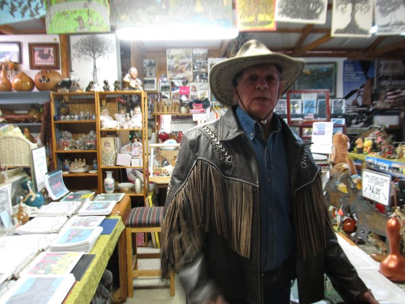 Glenn Earl Newman tells stories and gives a tour of his art gallery in Hazel, Ky.